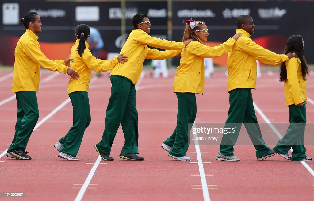The Brazilian pairs who finished first, second and third in the Women's 100m T11 parade their way to the medal podium during day four of the IPC Athletics World Championships on July 23, 2013 in Lyon, France.