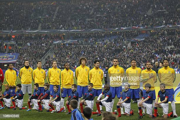 The Brazilian team line up to hear their national anthem before the start of the France versus Brazil friendly football match on February 9 2011 at...
