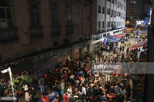 The Brazilian trio 'Jazz de Boteco' plays on the street in front of the 'Bar do Nanam' bar in Rio de Janeiro Brazil on August 24 2017 The legendary...
