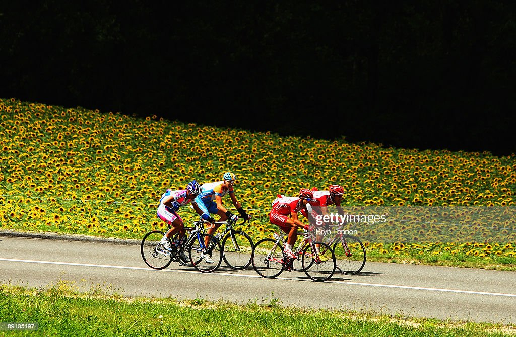 The breakaway group rides through the Swiss countryside on stage 15 of the 2009 Tour de France from Pontarlier to Verbier on July 19, 2009 in Verbier, Switzerland.