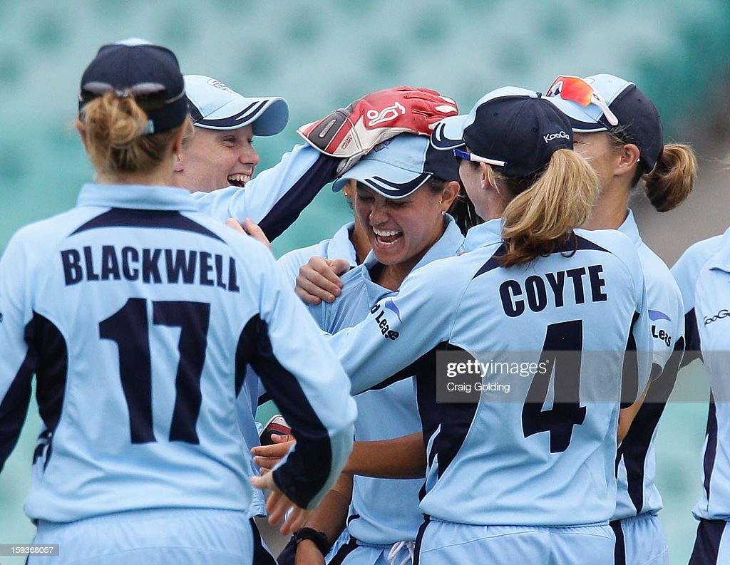 The Breakers celebrate after Angela Reakes caught Kirby Short of the Fire off her own bowling during the WNCL Final match between the NSW Breakers and the Queensland Fire at the Sydney Cricket Ground on January 13, 2013 in Sydney, Australia.