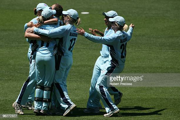 The Breakers players celebrate a wicket during the WNCL Final match between the NSW Breakers and the DEC Victoria Spirit held at the Melbourne...
