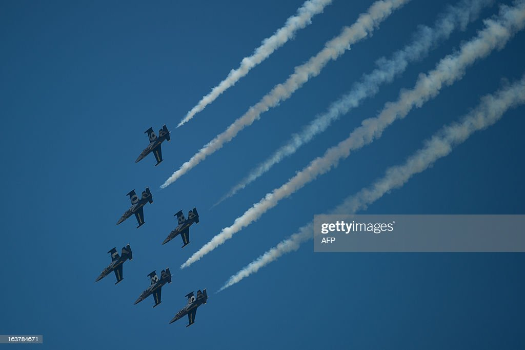 The Breitling jet team flies in formation as they perform an aerobatic display over Subang Skypark in Subang, outside Kuala Lumpur on March 16, 2013. The Breitling jet team is in Malaysia as part of their Asian tour. AFP PHOTO / MOHD RASFAN