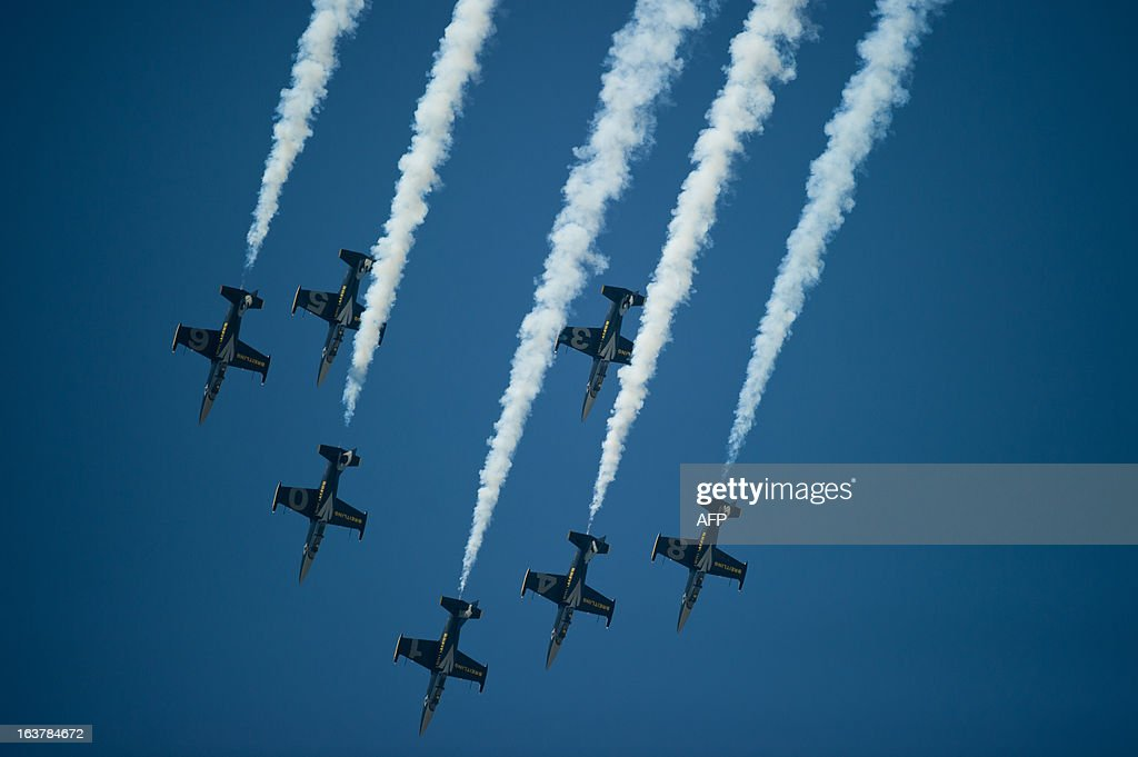 The Breitling jet team flies in formation as they perform an aerobatic display over Subang Skypark in Subang, outside Kuala Lumpur on March 16, 2013. The Breitling jet team is in Malaysia as part of their Asian tour.