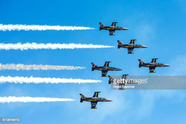 The Breitling L-39 Jet team performs a close formation fly by for the crowd at an air show.