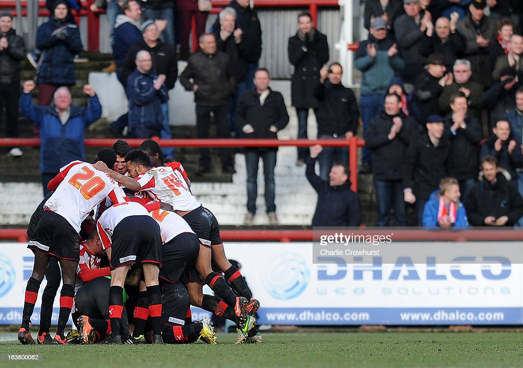 The Brentford players celebrate Sam Saunders late goal during the npower League One match between Brentford and Preston North End at Griffin Park on March 16, 2013 in London, England,