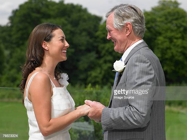 The bride and her father holding hands