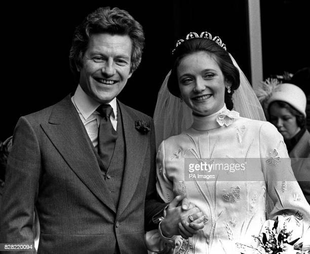 The bride Lady Leonora Grosvenor elder daughter of the Duke of Westmisnter wears a fown of heavy white silk crepe embroidered with butterflies in...