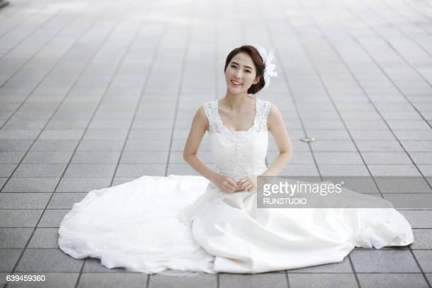 the bride posing on the street