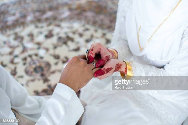 The bride wore a ring to the groom
