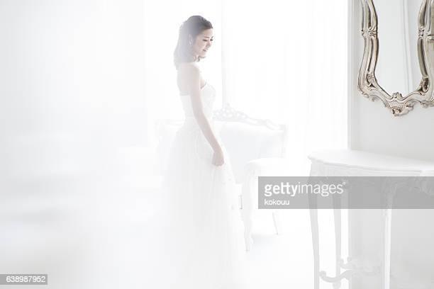 The bride wore a wedding dress.
