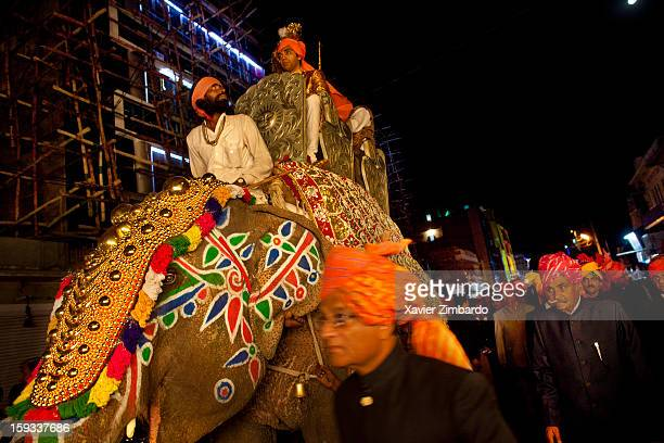 The bridegroom arrives to the bride city on an elephant with only male escort father grandfather relatives friends and a band on February 18 2011 in...