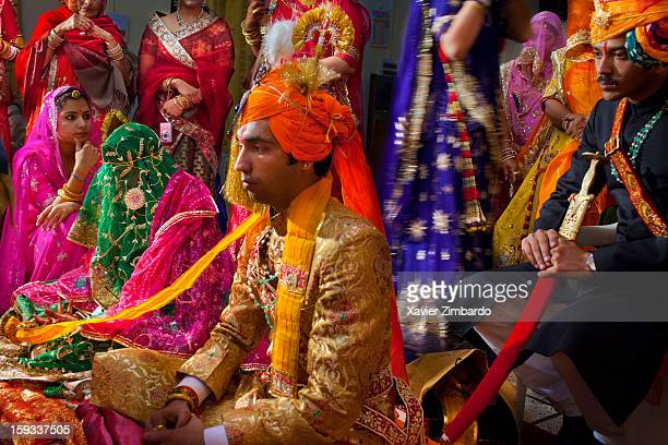 The bridegroom Rajeshwar Singh Jhala and the bride sitting at the bride family house with a symbolic 'tie up' made with a scarf between them on...