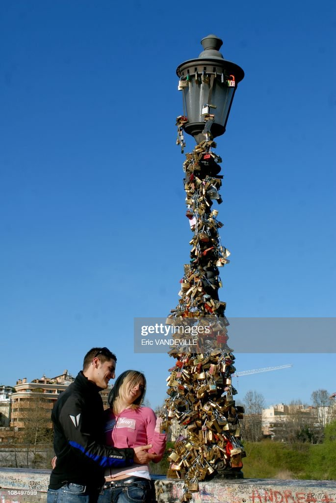 in Rome, lovers hang hundreds of padlocks on a lamp post on the city's most ancient bridge. According to the urban legend, lovers will spend their lives together if they write their names on a padlock and place it on the Ponte Milvio's third lamp post, then throw the key into the river Tiber over their shoulders to avoid seeing where it falls.Ponte Milvio owes its new reputation mainly due to two novels depicting the love of Roman teenagers. The books have become cult novels and were both made into movies. But recently Rome's Mayor <a gi-track='captionPersonalityLinkClicked' href=/galleries/search?phrase=Walter+Veltroni&family=editorial&specificpeople=558343 ng-click='$event.stopPropagation()'>Walter Veltroni</a> slapped a 50-euro fine on the romantic transgressors and wants to find an alternative location, so that one of the oldest monuments in the Italian capital could be 'freed'. Ponte Milvio (the Milvian Bridge) was the site of a famous battle between Maxentius and Constantine, two pretenders for the title of Roman emperor, on 28 October 312.