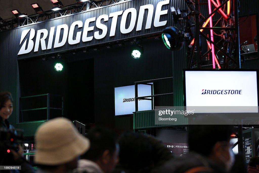 The Bridgestone Corp. logo is displayed at the Tokyo Auto Salon 2013 at Makuhari Messe in Chiba, Japan, on Friday, Jan. 11, 2013. The Tokyo Auto Salon runs until Jan. 13. Photographer: Kiyoshi Ota/Bloomberg via Getty Images