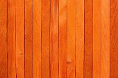 The bright orange wooden background. Colorful background.