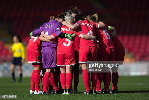 The Bristol Academy Women huddle at the start of the second half during the UEFA Womens Champions League Quarter Final match between Bristol Academy...