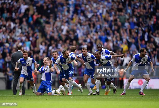 The Bristol Rovers players celebrate as Lee Mansell of Bristol Rovers scores the winning penalty in the shoot out during the Vanarama Conference...