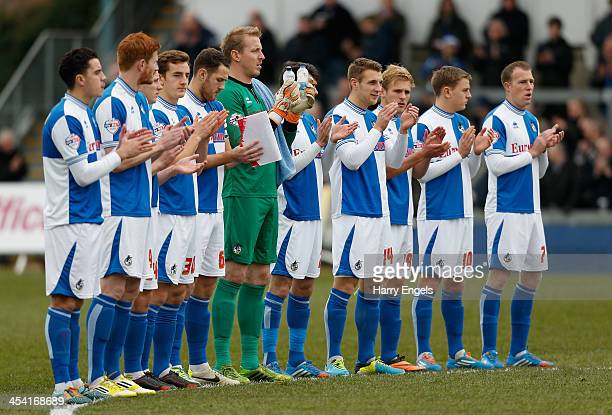 The Bristol Rovers team applaud for one minute in memory of Nelson Mandela prior to kick off during the FA Cup Second Round match between Bristol...