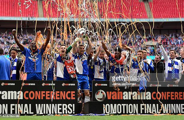 The Bristol Rovers team celebrate as Lee Brown of Bristol Rovers lifts the trophy following the Vanarama Conference Playoff Final match between...