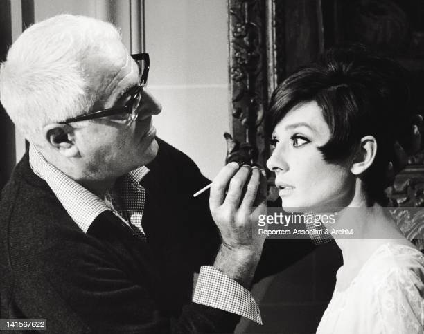 The British actress Audrey Hepburn being painted on the set of the film 'How To Steal a Million' by William Wyler 1965