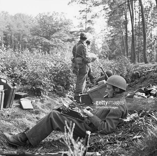 The British Airborne Division At Arnhem And Oosterbeek In Holland War Correspondent Alan Wood is seen typing his despatch cigarette in mouth while...