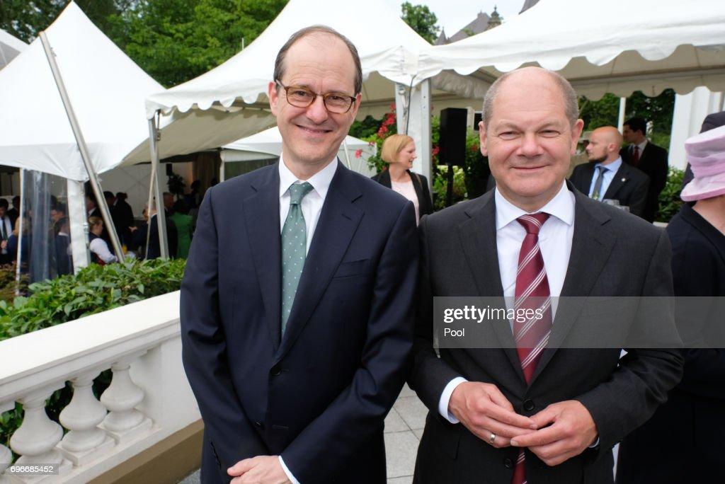 The British ambassador in Germany Sir Sebastian Wood and mayor Olaf Scholz attend a birthday party for Queen Elizabeth II June 15, 2017 in Hamburg, Germany.