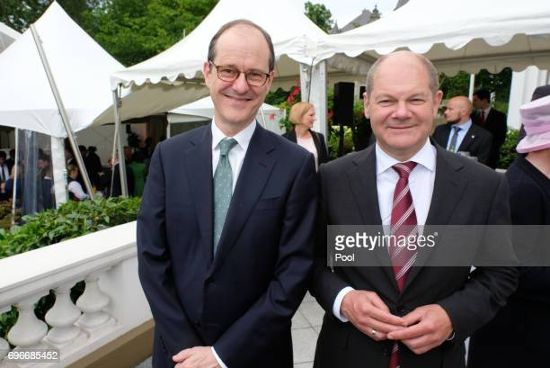 The British ambassador in Germany Sir Sebastian Wood and mayor Olaf Scholz attend a birthday party for Queen Elizabeth II June 15 2017 in Hamburg...
