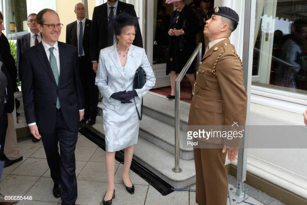 The British ambassador in Germany Sir Sebastian Wood and Princess Anne attend a birthday party for Queen Elizabeth II June 15 2017 in Hamburg Germany