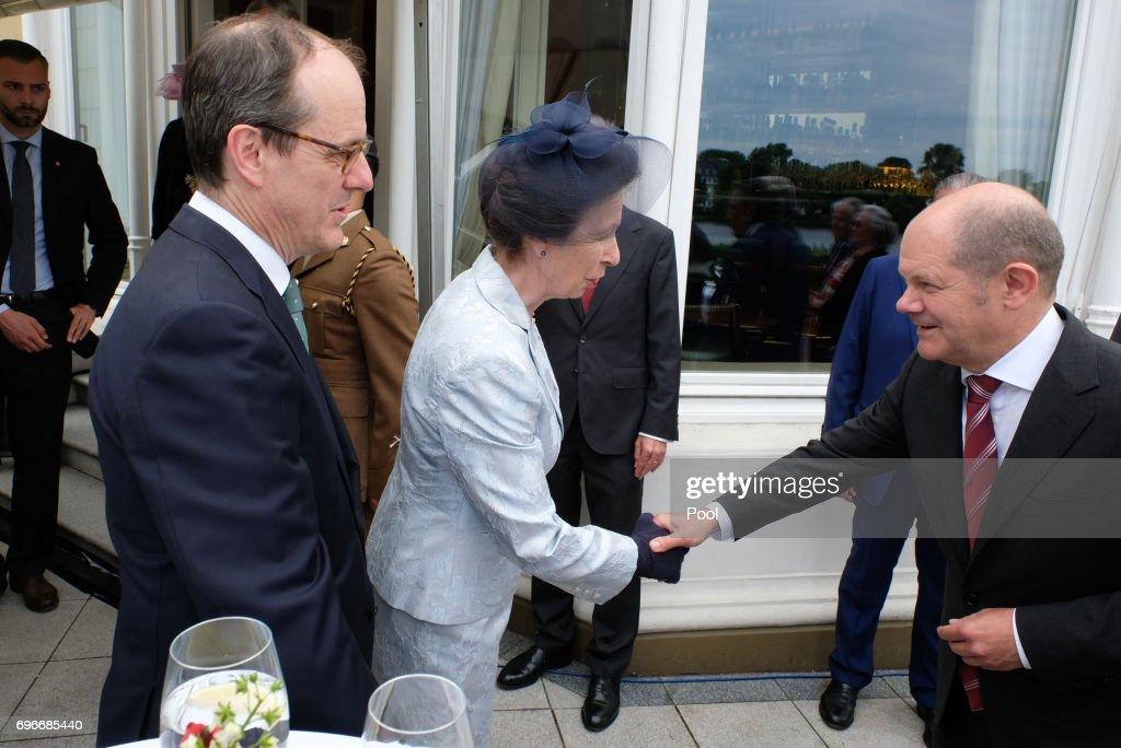 The British ambassador in Germany Sir Sebastian Wood and Princess Anne with mayor Olaf Scholz attend a birthday party for Queen Elizabeth II June 15, 2017 in Hamburg, Germany.