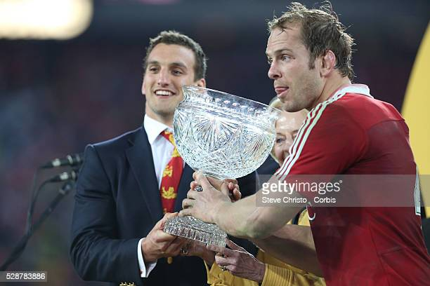 The British and Irish Lions captains Sam Warburton and Alun Wyn Jones hold up the Tom Richards trophy after beating Australia 41 to 16 at Stadium...