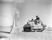 The British Army In North Africa 1940 The crew of a Bren gun carrier pause on their way to the forward area in the Western Desert to look at a...