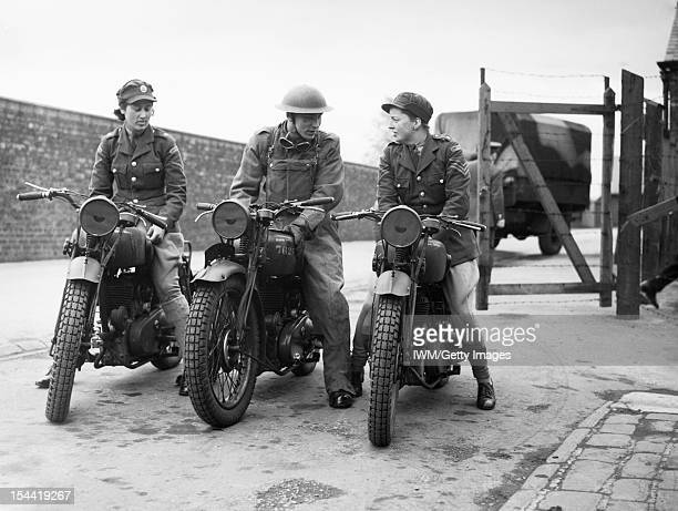 The British Army In The United Kingdom 193945 Two ATS trainee motorcycle despatch riders and a Royal Army Service Corps instructor at York 23 May 1941