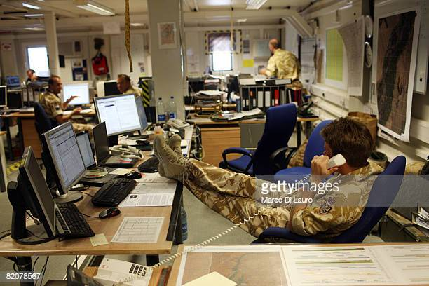 The British Army Task Force Helmand Chief of Staff speaks on the phone in the Operation Room at the British army base Task Force Helmand Headquarter...