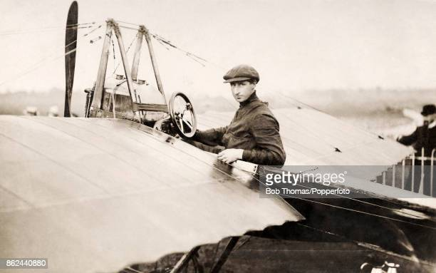 The British aviation pioneer R W R Gill posing in the cockpit of his aircraft at an airfield in the south of England circa 1912