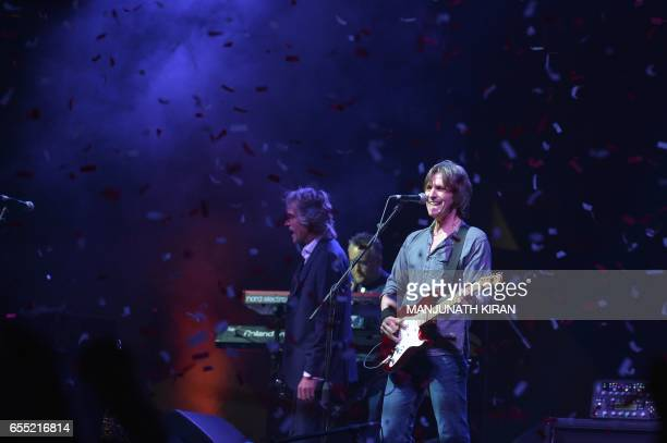 The British band Dire Straits Experience perform during the 'Play for a Cause' concert in Bangalore on March 19 2017 / AFP PHOTO / MANJUNATH KIRAN
