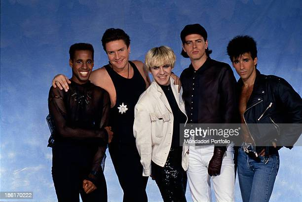 The British band Duran Duran smiling The band is formed by British singer Simon Le Bon British keyboard player Nick Rhodes ItalianAmerican guitarist...