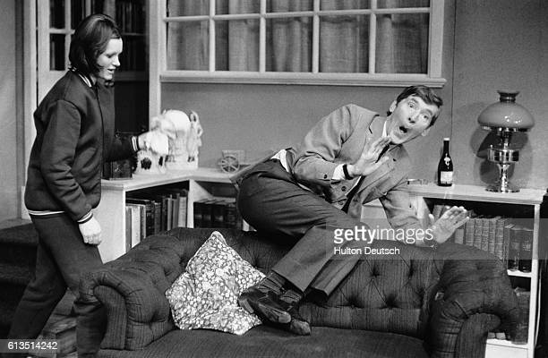 The British comedy actor Kenneth Williams on set with Jenny Linden in My Fat Friend