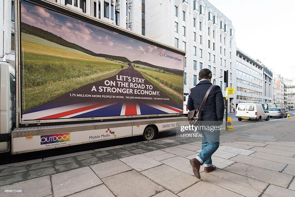 The British Conservative Party unveil their first 2015 national election campaign poster in Westminster central London on January 2 2015 Britons will...