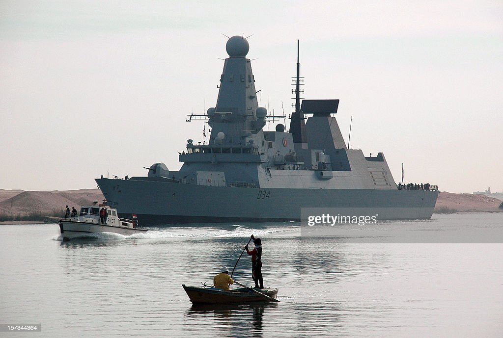The British destroyer HMS Diamond sails through the Suez Canal on December 2, 2012, close to the port city of Ismailia, some 120 km north east of the capital Cairo, as it sails from the Red Sea towards the Mediterranean on its way backs home after months in Arabia Sea and Gulf of Aden where she took part in war games with American navy war ships of the 5th Fleet.