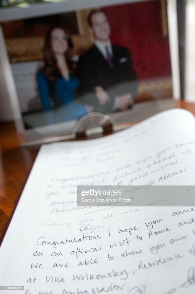 The British Embassy in Rome presents a book of signatures to celebrate the royal wedding of Prince William and Kate Middleton on April 28, 2011 in Rome, Italy. The wedding of Britain's Prince William and his fiancee Kate Middleton will be celebrated at Westminster Abbey in London on April 29, 2011.