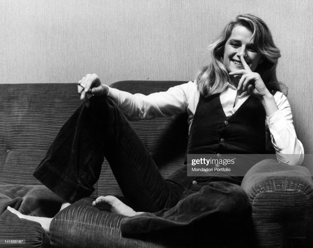 The British film actress <a gi-track='captionPersonalityLinkClicked' href=/galleries/search?phrase=Charlotte+Rampling&family=editorial&specificpeople=212770 ng-click='$event.stopPropagation()'>Charlotte Rampling</a> smiles sitting on a sofa. Milan, 1974