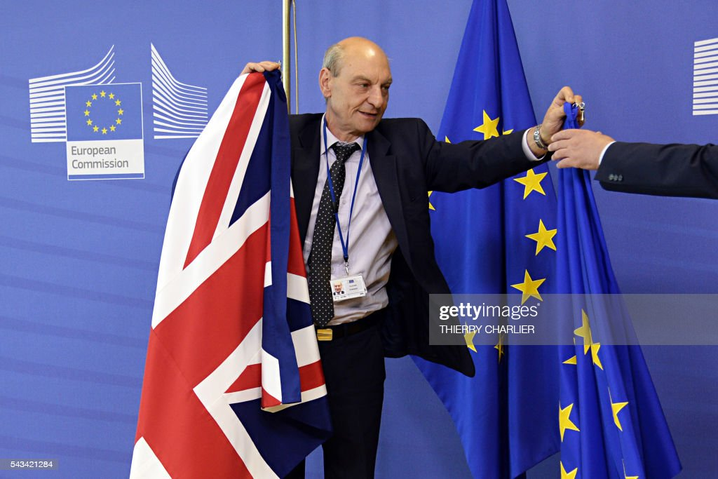 TOPSHOT - The British flag is being replaced by the European Union flag following the visit of British Prime Minister David Cameron at the European Union Commission headquarters in Brussels on June 28, 2016. / AFP / THIERRY