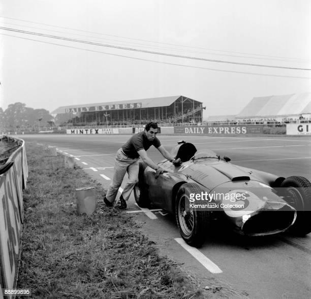 The British Grand Prix Silverstone July 14 1956 Alfonso de Portago pushing his FerrariLancia around Woodcote Corner to the finish line