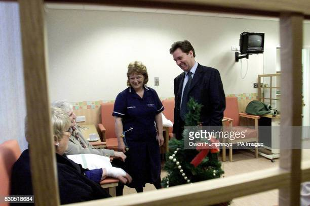 The British Health Secretary Alan Milburn and an nurse meet patients during a visit to Newcastle General Hospital where he announced 875 million cash...