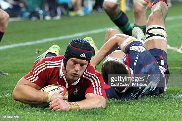 The British Irish Lions' Sean O'Brien scores a try ahead of Melbourne Rebels' Luke Jones