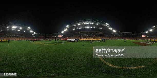 The British Lions and Wallabies teams line up during the signing of the national anthem before the International Test match between the Australian...