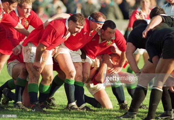 The British Lions front row of Jason Leonard Brian Moore and Nick Popplewell prepare to scrummage during the second test match between New Zealand...