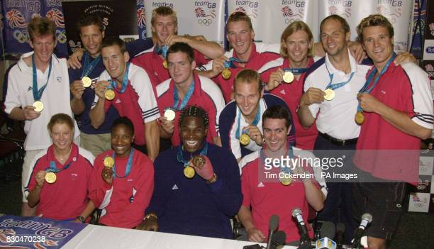 The British Olympic Chmpions show off their gold medals during a news conference at London's Heathrow Airport when they returned from Sydney with...