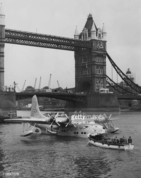 The British Overseas Airways Corporation Short Solent passenger flying boat City of London docks at her new berth near Tower Bridge in London on 7...